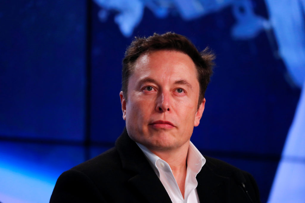Musk looks on at SpaceX Falcon 9 post-launch news conference in Cape Canaveral