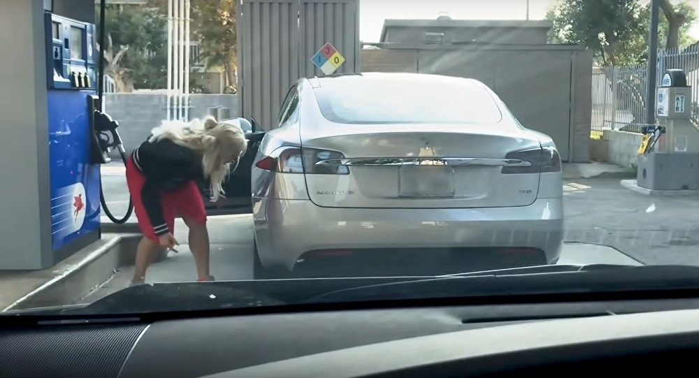Tesla at gas station