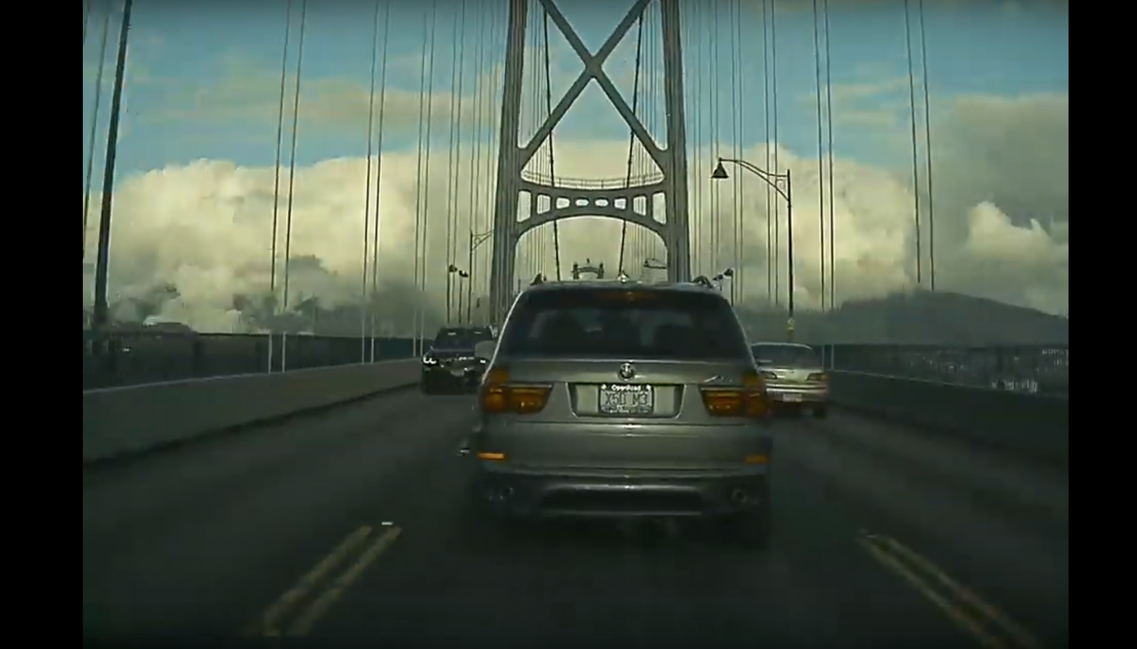 BMW X5 Lions Gate Bridge Tesla