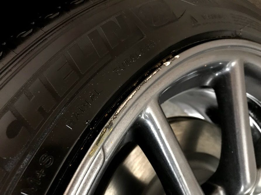 Tesla Model 3 Aero rim curb rash