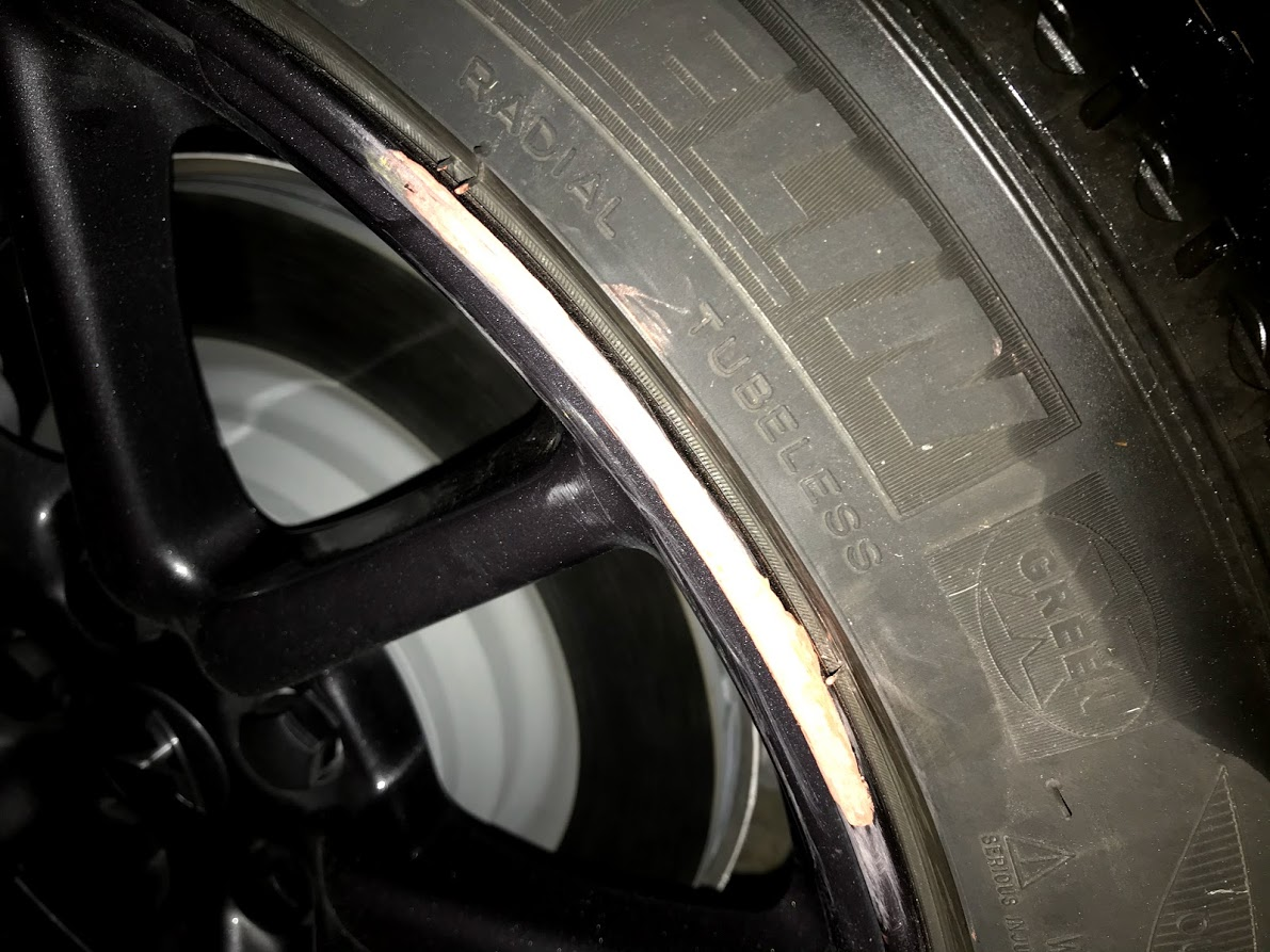 Tesla Model 3 Aero rim curb rash repair after sanding bondo