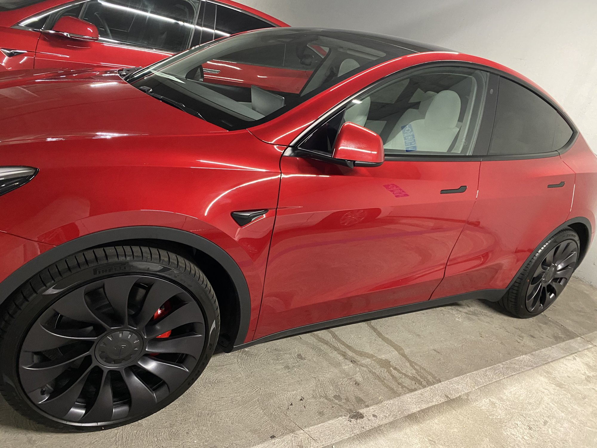 Red Tesla Model Y with white interior
