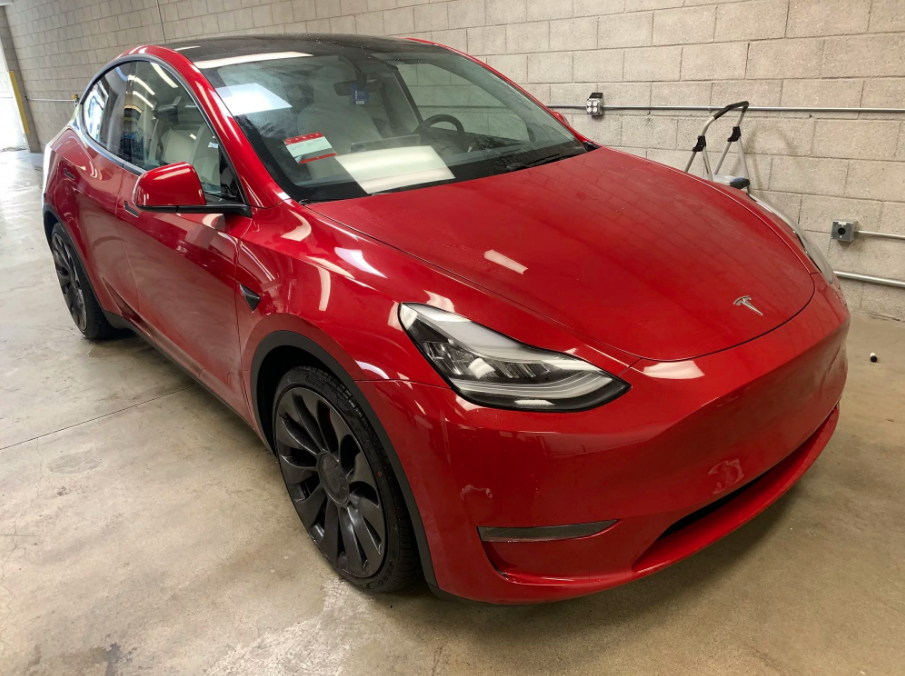 Red Tesla Model Y with white interior 3