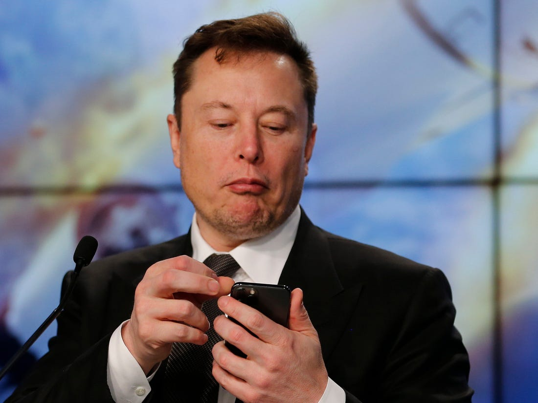Elon Musk on his phone