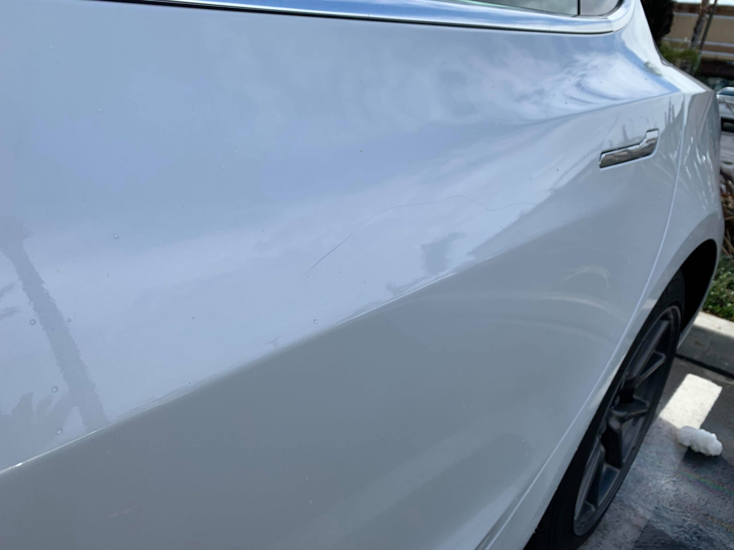 Tesla keying rear door